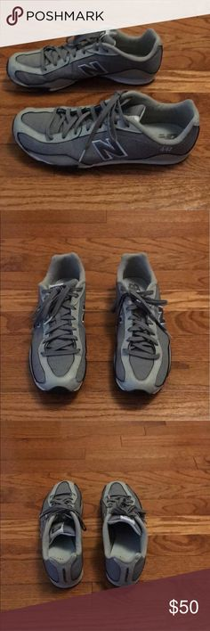 New Balance Sneakers Grey and blue new balance sneakers. Gently used, in good condition. New Balance Shoes Athletic Shoes