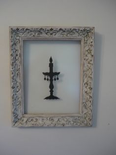 Framed Candelabra silhouette on glass.