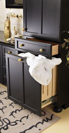 A Pull Out Hamper keeps your dirty laundry behind closed cabinet doors.