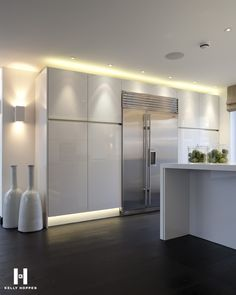 beautiful gloss white kitchen - stunning lighting and accessories - Kelly Hoppen for Regal Homes @ Circus Road www.kellyhoppen.com www.regal-homes.co.uk