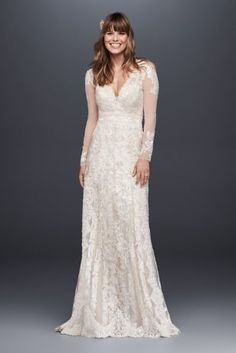 This artisanal sheath wedding dress is crafted using four types of lace appliques creating a captivating, linear motif. Designed with long illusion sleeves and a deep V-neckline, this gown is a romantic and ethereal option for the vintage-inspired bride.  Melissa Sweet, exclusively at David's Bridal  Polyester  Sweep train  Back zipper; fully lined  Dry clean  Imported  Also available in petite and extra length Protect your dress for years to come with our Wedding Gown Preservation Kit.