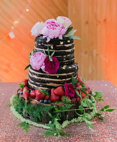 naked chocolate cake with peonies. The link has an amazing wedding story.