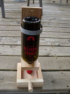 Wine bottle bird feeder by ShapelyWood on Etsy, $18.50