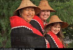 Portrait of Tlingit women wearing a traditional Chilkat button blanket