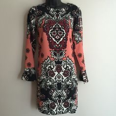 $15 PRICE DROP H&M Printed Shift Dress Omg I'm in love! The colors are exquisite! There are two slits on each side of the dress. Buttons up in the back. Listed as size 4. Can fit a small and medium. H&M Dresses Midi