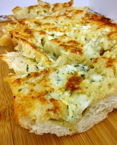 Gorgonzola Garlic Bread Recipe - french bread topped with butter, garlic, gorgonzola and parmesan - SOOO good! Great with pasta!