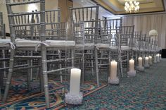Wedding aisle lined with candles.