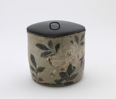 Tea ceremony water jar, unknown workshop | Stoneware with white slip and iron pigment under feldspathic glaze | Edo period | Japan | late 18th-mid 19th century | Gift of Charles Lang Freer | Freer Gallery of Art and Arthur M. Sackler Gallery | F1899.11a-b