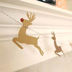 This DIY reindeer garland is the perfect touch to your holiday mantle decor. Downloadable template included!