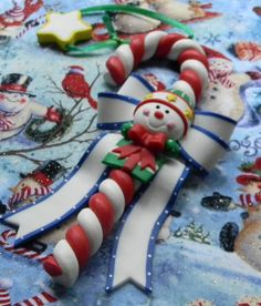 Snowman Candy Cane Christmas ornament can be by ColorMeSweetLINY, $10.00 Easy Ornaments, Polymer Clay Ornaments, Diy Christmas Ornaments, Clay Projects, Clay Crafts, Christmas Makes, Christmas Time, Xmas Pictures, Polymer Clay Christmas