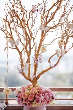 Thinking this would be pretty with branch painted gold as a centerpiece for a girl's party!