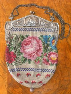 Beaded floral, 800 silver cherub frame
