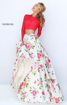 two piece prom dress with floral ballgown skirt and long sleeve lace top Sherri Hill prom dress available at Hope's Bridal