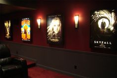 Display movie posters and put art spotlights above each poster.