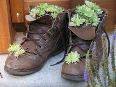 15 Ideas How to Reuse Old Shoes for Your Flowers -- I'm going to sneak my son's old work boots - hee hee hee