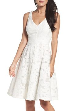Free shipping and returns on Maggy London Fit & Flare Dress at Nordstrom.com. Bright and summery in white floral lace, this sophisticated sundress sculpts an hourglass silhouette with contoured seaming all throughout.