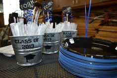 """Graduation decorations - For the buffet I used galvanized buckets with Dollar Tree stickers and Cricut graduation hats.  Chalkboard signs complete the look.  Yes, the """"r"""" is supposed to be backwards. :)"""