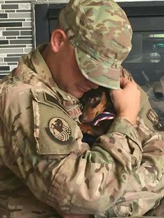 Two important things to have in life, a soldier and a doxie. I have both.