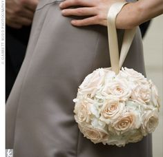 This is a cool idea... instead of a bouquet the girls could have flower balls... I kinda like it