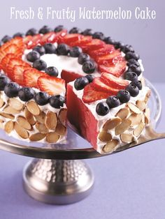 """Watermelon """"cake"""" decorated with yogurt - I use Greek Yogurt - and fresh fruit, you can customize this to your exact taste and it's delicious, no matter how you put it together!"""