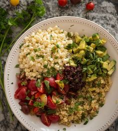 Rawmazing Quinoa Bowl - Quinoa, avocado, corn, tomatoes, and olives. Everything but the quinoa is served raw. Note that I don't like to call the recipe by its original name, a Buddha Bowl, as that's cultural appropriation.