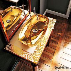 Drops of sheer gold in a bathroom sink.