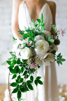 Stick with traditional white with this monochromatic wedding bouquet of peonies, roses, and more. Make the bouquet look organic with overflowing greenery. This bouquet went perfectly with the brides simple and airy wedding dress. This look is perfect for a minimalist, but romantic spring or summer wedding. Head to the link for more peony bouquet inspo! // Photo: Alexandra Wallace