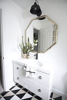 installing a Delta Touch faucet on an Ikea floating vanity | different faucet for Ikea Godmorgon vanity | black and white bathroom | how to install a @deltafaucet faucet on a modern floating vanity via @jakonya