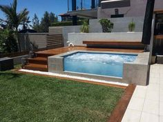 contemporary glass wall pool with above ground design