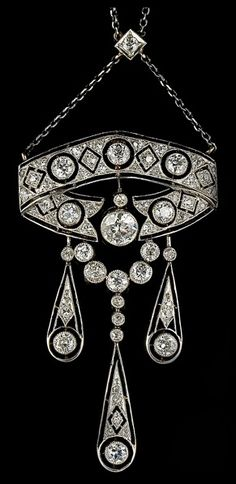 Diamond necklace, circa 1900. Mounted in platinum and yellow gold, and set with approximately 4.8ct. of old-cut diamonds. The pendant can be detached to be worn as a brooch.