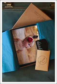 Portrait boxes with metallic paper, prints inside a crystal clear bag.