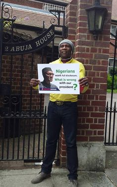 Nigerian man protests in front of Buharis residence in London