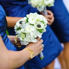 White Bridesmaid Bouquet: Pretty. Not a fan of those dresses, though.