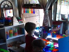 beautiful area for a  light table. lots of colourful and transparent objects to explore with