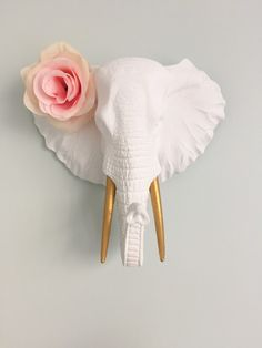 Pretty Pastels and Gold Nursery - Project Nursery This modern faux taxidermy elephant head gets a girly touch with a flower in its ear!