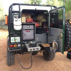 Cooking Setup In a Green Land Rover Defender