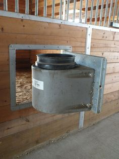 """Swing out doors with insulated bucket holders—my one """"splurge"""" when we built the barn. Keeps water from freezing in winter!"""