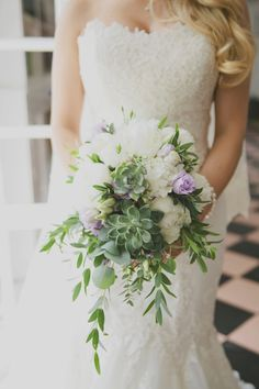 | Grasse Garden Wedding | For the Brides Bridal Bouquet, the couple took inspiration from their beautiful surroundings and brought the natural Provencal garden to their wedding flowers. The soft colours of white peonies, lilac lisianthus, succulents and eucalyptus, perfectly complimented the bridesmaids sage dresses and the brides stunning lace dress. We added a few baby succulents to the groom and groomsman buttonholes to complete the look of the wedding party. Images by Pure White…