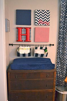 Henry's changing table, DIY fabric-covered wall art and hanging storage.