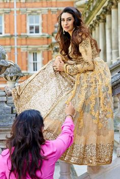 Karishma Kapoor in a light yellow lehenga