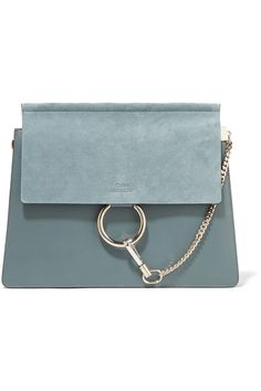 Blue leather and suede (Calf) Snap-fastening front flap Designer color: Cloudy Blue Weighs approximately 3.3lbs/ 1.5kg   Made in Italy