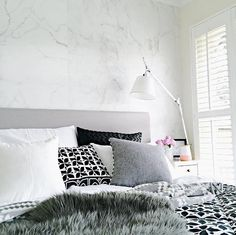 """We love that The Stylist Splash used our """"Marble"""" wallpaper to renovate her bedroom."""