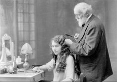 "A Marcel curling iron first received its name from Marcel Grateau (1852-1936), who invented a new way to curl your hair by heating iron curlers on a hot stove. The curls were very similar to a ""finger wave"""