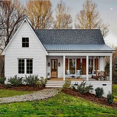 This home...posted by @countrylivingmag...is so dreamy!  Can you not just imagine setting up tea or mimosas on that front porch?!! #home #fromtheheart #finishingtouches