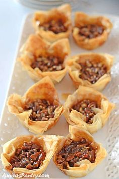 In Phyllo Cups Phyllo pastry cups filled with traditional pecan pie. Take pecan baklava to the next level with a step by step on how to make phyllo cups. Phyllo Recipes, Pastry Recipes, Dessert Recipes, Eid Recipes, Mini Pecan Pies, Pecan Tarts, Phyllo Cups, Phyllo Dough, Bite Size Appetizers