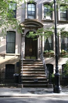Carrie Bradshaw's brownstone apt., NYC. 66 Perry Street, between Bleeker and 4th