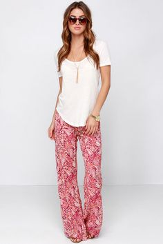 "For the beach, brunch, or a weekend festival, the Billabong Midnight Hour Red Paisley Print Pants are extremely ""lounge"", and incredibly cute! Breathable woven crepe gets energized by a deep red, coral, and mint paisley print over relaxed-fit, flared legs. Elastic waistband. Metal logo tag at back. Unlined. 100% Rayon. Hand Wash Cold. Imported."