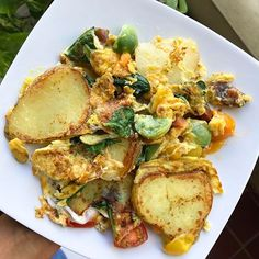 Delicious breakfast mess     Organic eggs   Potatoes   Spinach   Cherry tomatoes   Bit of Organic Cheese  .  Yum Yum