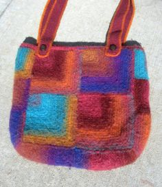 Hand made felted wool tote bag in bright colors and mitered stitch pattern, self striping Noro yarn