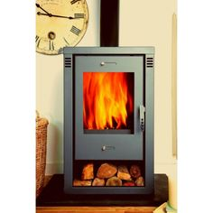 If get a log burning stove like this one, you needn't to buy storage rack for storing a few days of firewood in the cold winter. Log Burning Stoves, Wood Burning, Contemporary Furniture, Modern Contemporary, Seasoned Wood, Grey Fireplace, Multi Fuel Stove, Heat Resistant Glass, Log Burner